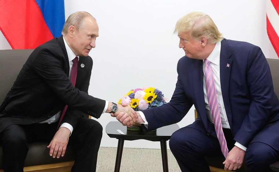 President Trump and Russian President Vladimir Putin shake hands at the G20 summit in Osaka, Japan on June 28, 2019.