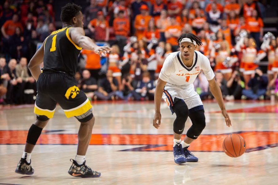 Current senior Trent Frazier surveys the  in court front of him during the game against Iowa on March 8. The Illini beat the Hawkeyes 78-76.