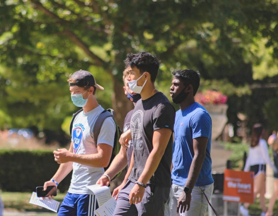 Students+wearing+masks+walk+through+the+Main+Quad+on+Aug.+21.+Since+classes+began%2C+there+have+been+over+1%2C100+new+coronavirus+cases+on+campus.