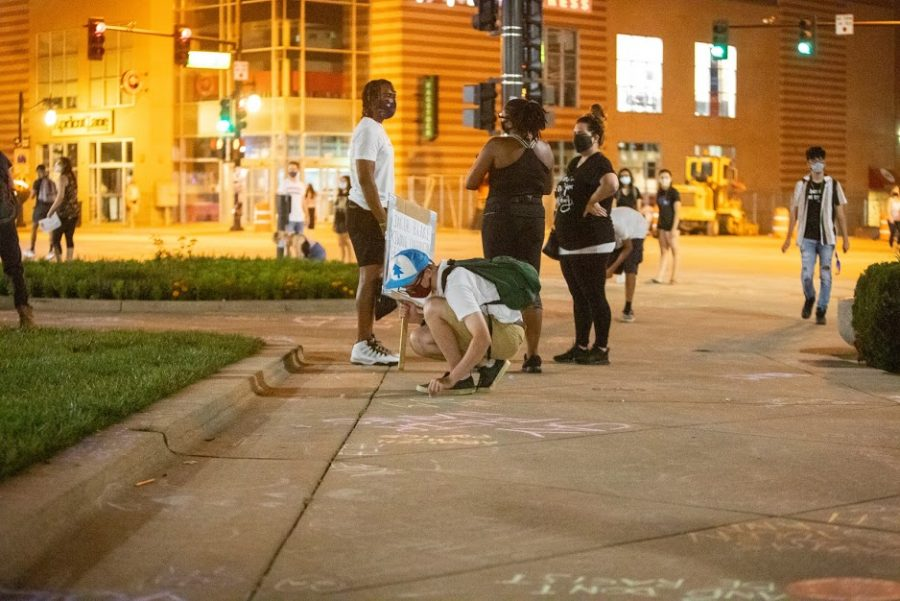 Students draw on the cement in front of Alma Mater in chalk following the CC-ARC protest on Aug. 28. The University quickly washed the chalk drawings away after the protesters left the scene.