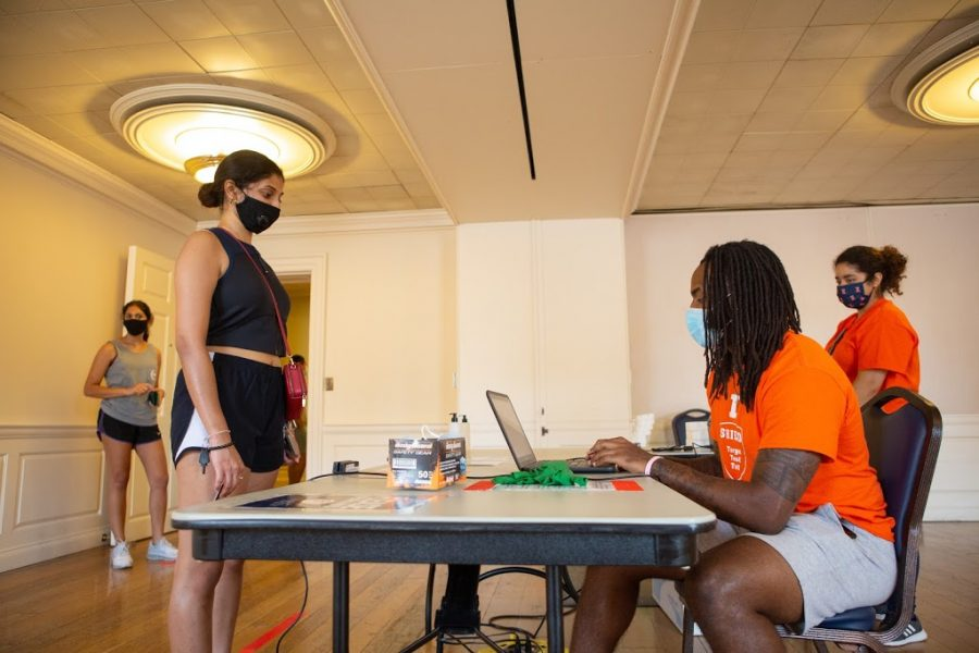 Aisha Shekara checks into the COVID-19 testing site at the Illini Union on Aug. 23. The University has now conducted over