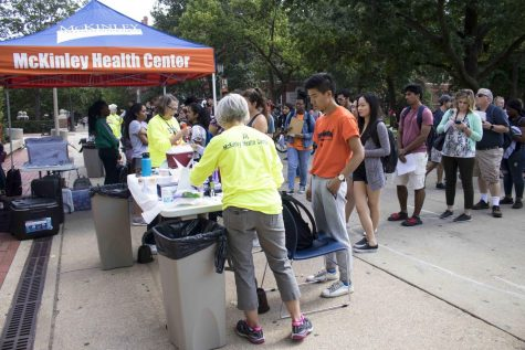 Students line up on the Main Quad to get flu shots at McKinley Health Center's Flu Shot Clinic on Oct. 1, 2018. Health officials encourage flu shots to avoid overwhelming hospitals this winter.