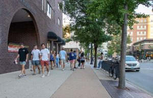 A group of students walk down Green Street without masks on Aug. 21. More than 1,200 people have tested positive for COVID-19 in the first two weeks of school.
