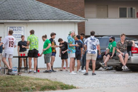 Students party in the driveway of a house located on First Street on Aug. 28. Some on campus residents received court notices due to breaking social distancing measures.  The students pictured are not necessarily those that received court notices.
