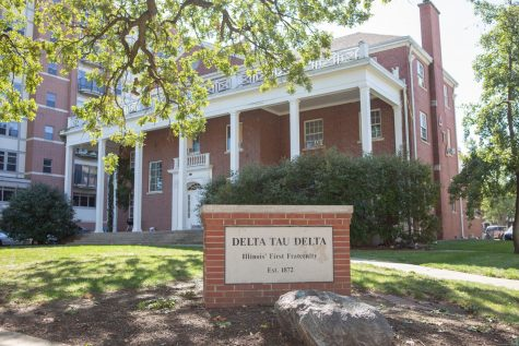 The Delta Tau Delta fraternity house sits on the corner of Fourth and East John streets on Sunday morning. The fraternity was suspended after hosting a large party on Thursday.