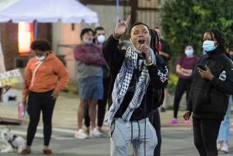 Organizer Drake Materre, a graduating senior in the college of AHS, speaks to protestors outside of Red Lion during the Dead Lion protest on Thursday, Sep. 17.