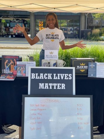 Mariah Madison stands at a Buy Black Chambana pop-up shop in August. Madison's blog sponsors Black-owned businesses within the Champaign-Urbana area.
