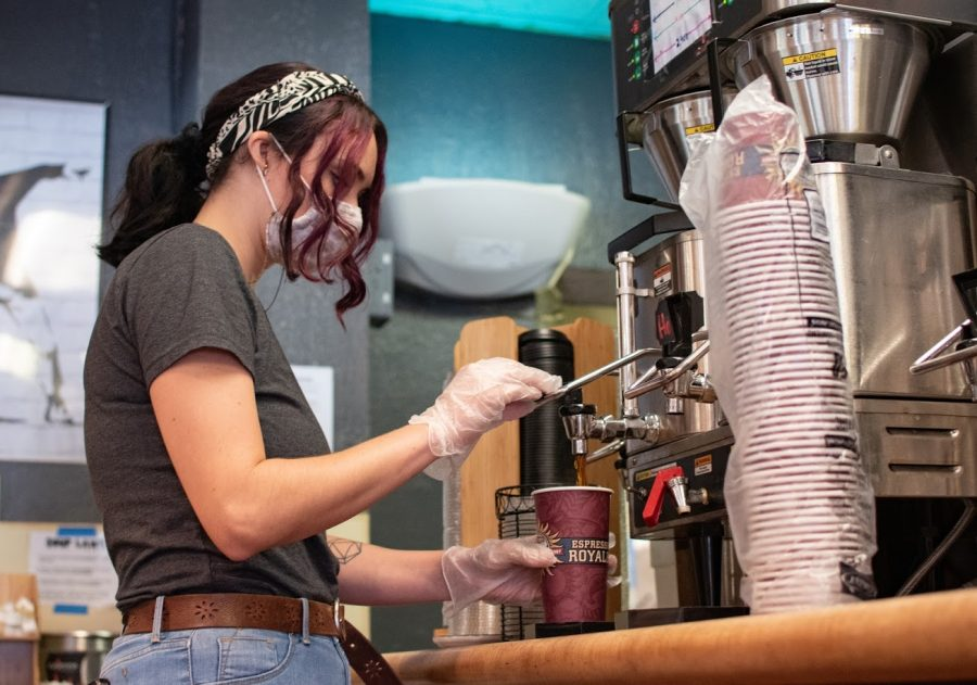 Anika Nims, assistant manager of the Espresso Royale on Oregon Street, prepares a coffee order on Tuesday. Champaign-Urbana's Espresso Royale locations reopened under the name Espresso Royale C-U.