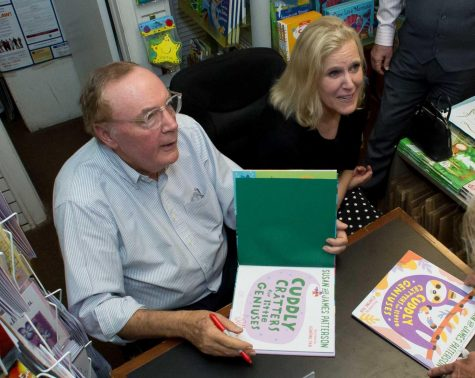 Best-selling author James Patterson signs a book for a fan inside Classic Bookshop during 2018 in Palm Beach, Florida. Columnist Noah argues Patterson has earned the title of a literary hero.