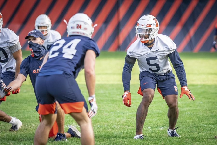 Senior linebacker Milo Eifler stands ready before the play during football practice on Sept. 17. Eifler is one of several Illini that will consider the NFL Draft after the fall.