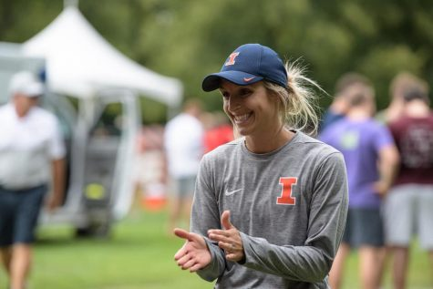 Women's cross country and track head coach Sarah Haveman claps at a cross country meet,