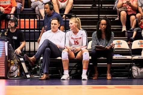 Head volleyball coach Chris Tamas speaks with current senior Megan Cooney during the game against Tennessee on Sept. 1, 2019.