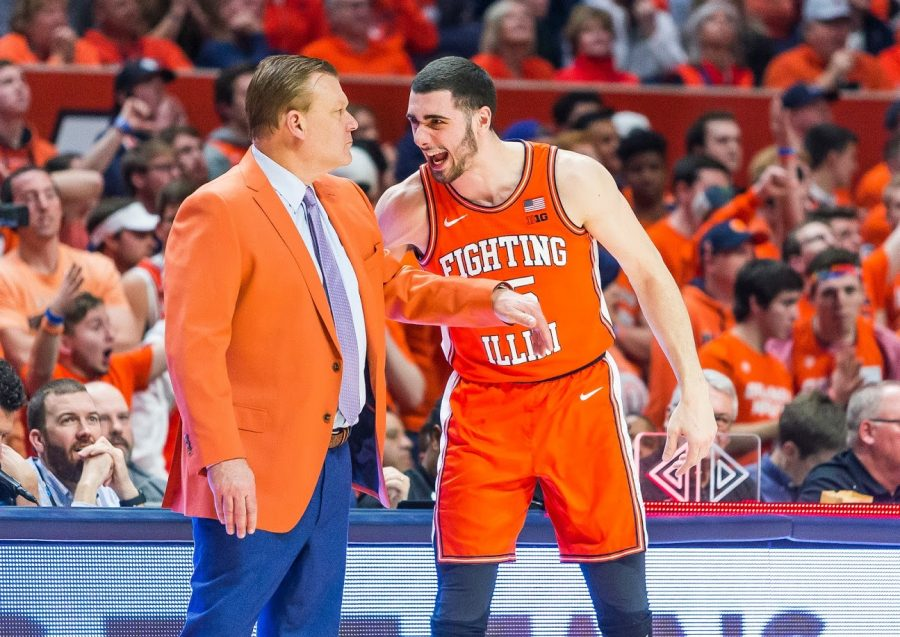Junior Giorgi Bezhanishvili speaks to head coach Brad Underwood during the second half of the game against Michigan State at State Farm Center on Feb. 11. The NCAA recently clarified there will be a college basketball season for 2020-2021.