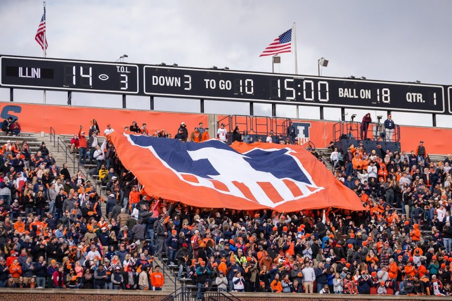 The Block I student section hoists a banner with the Illinois shield logo during the game against Minnesota at Memorial Stadium on Nov. 3, 2018. Illinois announced its Freshman of the Year nominees on Tuesday.