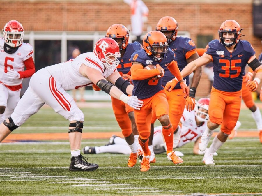 Senior+Nate+Hobbs+returns+an+interception+during+the+game+against+Rutgers+on+Nov.+2+at+Memorial+Stadium.+The+Illini+won+38-10.