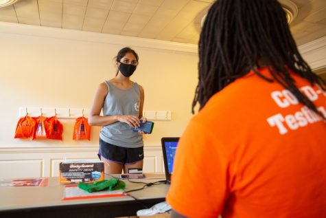 Kushi Gowda checks in at the coronavirus testing site located on the third floor of the Illini Union on Aug. 23. Champaign County has reported 364 new cases over Labor Day weekend.