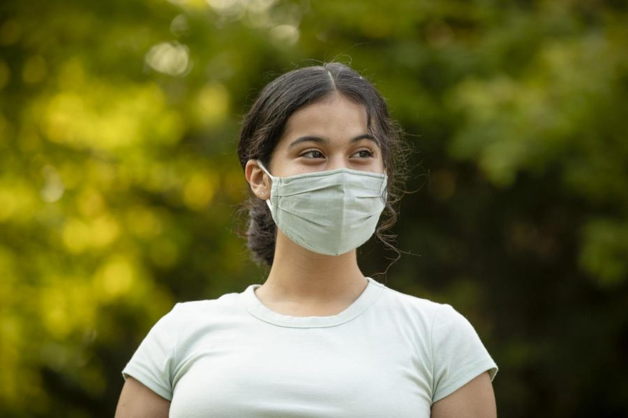 Jahaira Bustos, freshman in AHS, wears a face mask outside. Bustos became a wellness ambassador earlier this year.