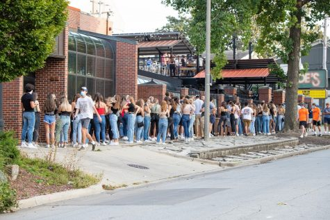 Students fill the sidewalk outside of Joe's Brewery waiting to enter on Thursday afternoon. The line stretched from the front gate to Potbelly Sandwich Shop on Fourth street.