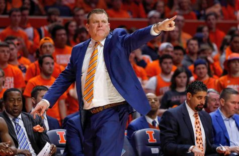 Illinois basketball coach Brad Underwood points toward the court during the game against Nebraska at the State Farm Center in Champaign on Feb. 24. Though the Illini have been successful on the recruiting trail, two top 2021 targets, Brandon Weston and David Jones, committed elsewhere.