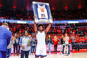 Recent graduate Andrés Feliz hoists a frame containing his jersey during Senior Night before the game against Iowa at State Farm Center on March 8. Feliz has left big shoes to fill after he graduated in the spring.