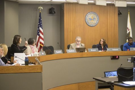 The Champaign City Council members discuss and vote on proposed bills on April 18, 2018.