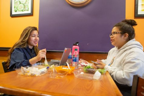 A pair of roommates eat lunch at the Bevier Cafe on Thursday afternoon. Setting boundaries can help negate conflict with your roommate.