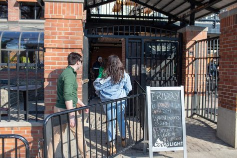 Students enter Joe's Brewery during Unoffical  on March 1, 2019.