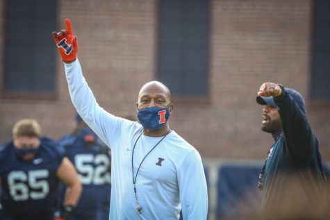 Illini football head coach Lovie Smith waves at the team's first practice since the BIg Ten's decision to reinstate the fall football seaosn. The Illini have roughly four weeks to practice before the season begins.