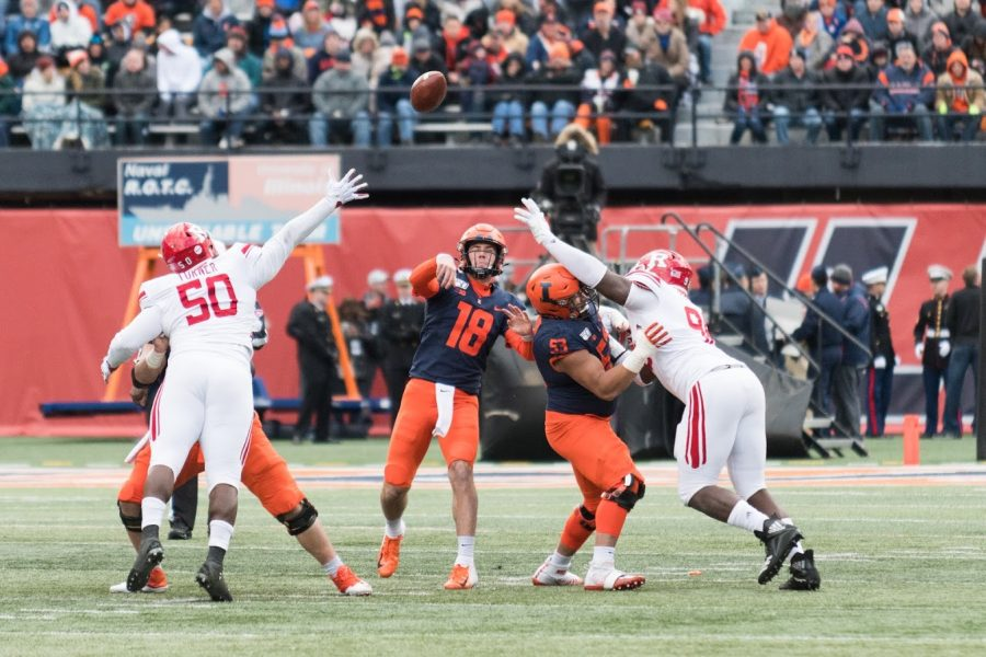 Illinois quarterback Brandon Peters launches a pass during the game against Rutgers on Nov. 2, 2019.