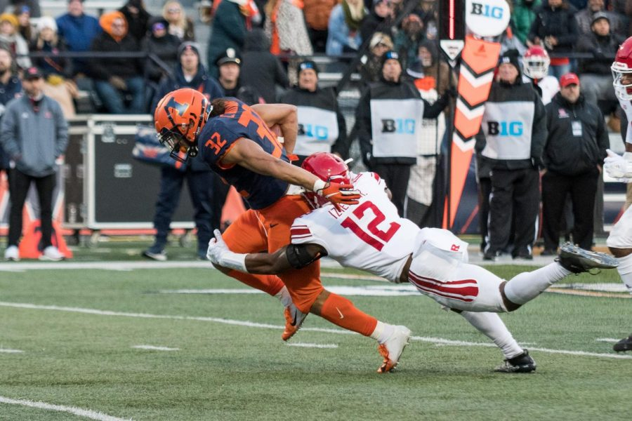 Illinois running back Chase Brown fights for yardage during the game against Rutgers.  The Illini won 38-10.