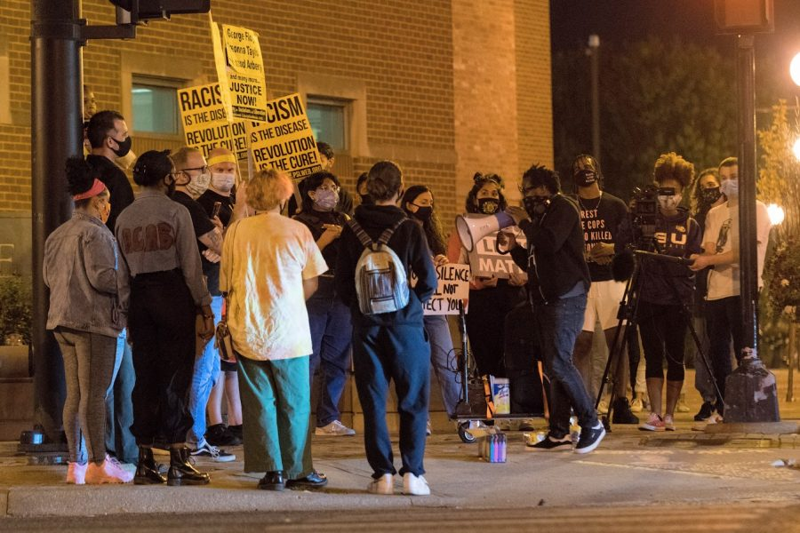 Protestors gather outside the Champaign Police Department on Wednesday in response to the grand jury decision regarding the killing of Breonna Taylor.