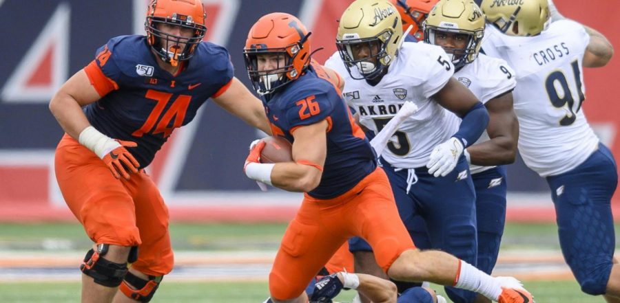 Current senior Mike Epstein runs the ball during the game against Akron on Aug. 31, 2019 at Memorial Stadium.