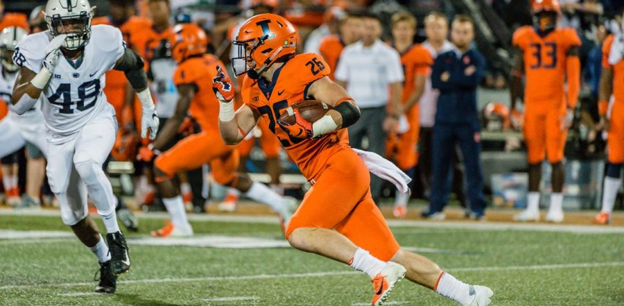Junior Mike Epstein advances the ball down the field during the game against Penn State on Sept. 21, 2018.  Epstein and sophomore Chase Brown will be given a majority of the carries for the Illini this season.