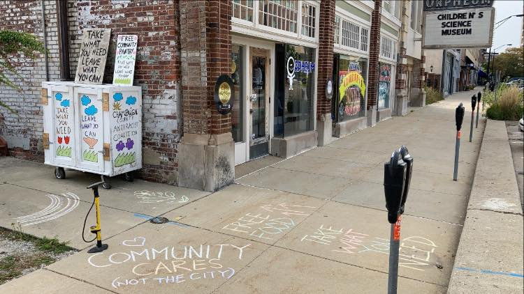 Words+drawn+in+chalk+are+displayed+outside+the+Downtown+Community+Food+Pantry+near+Orpheum+Children%27s+Museum+on+Tuesday+afternoon.+The+pantry%27s+keepers+were+forced+to+move+the+pantry+from+its+spot+on+Washington+Street+for+blocking+a+sidewalk.