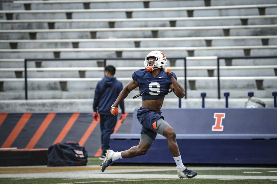 Senior wide receiver Josh Imatorbhebhe turns to catch a pass during football practice on Oct. 15.