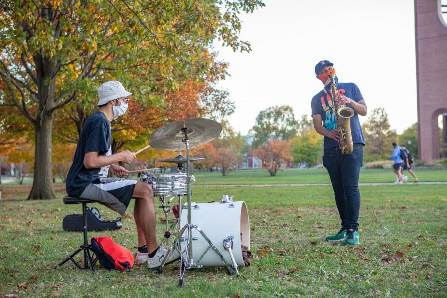 Senior Shravan Raghuram performs on the drums alongside senior saxophonist Kevin King on the South Quad on Oct. 22.