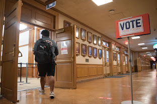 A student enters the early voting site located at the Illini Union on Friday afternoon. Many first-time voters on campus opted for in-person locations.