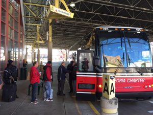 Customers board a Peoria Charter bus on Aug. 6. Peoria Charter is concerned it may be forced to close in November should they not receive federal or state aid.