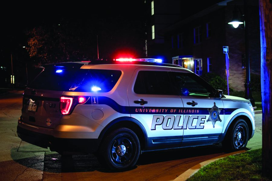 University of Illinois police respond to a call at the corner of South Third and East John streets on Sept. 29. A suspect has now been arrested by the Champaign Police Department for a murder committed in February.