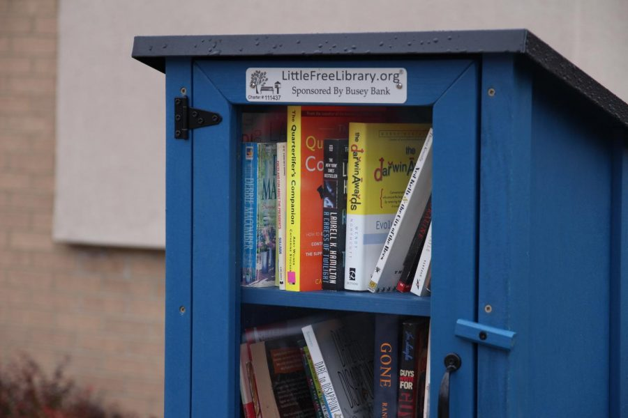 A Little Free Library dropbox sits outside of the Busey Bank located on 909 W. Kirby Ave. on Tuesday afternoon. There are currently 28 Little Free Libraries in Champaign-Urbana.