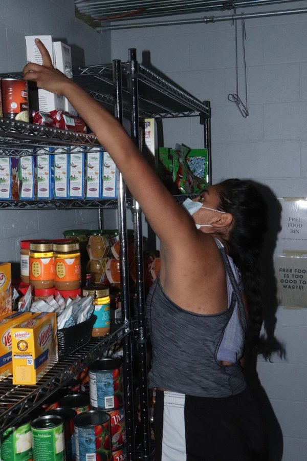 Senior+Cindy+Alcala+grabs+a+food+item+from+the+ARC+Food+Assistance+and+Well-Being+Program+on+Oct.+10.+Pantries+like+the+one+at+the+ARC+provide+food+for+students+and+community+members+facing+food+insecurity.