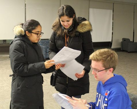 A trio of biology students discuss a homework assignment in the main lounge of Allen Hall on March 9, 2019. University Housing plans to suspend and review the Multicultural Advocate position for the 2021-2022 school year.
