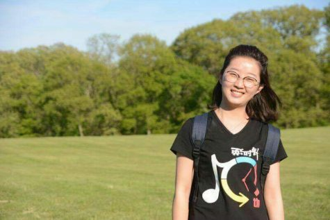 Yingying Zhang stands in an open field. Zhang was reported missing in 2017.