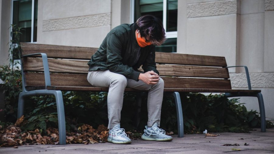 Bryan Kang, sophomore in Business, sits on a bench outside Wassaja Hall on Sunday afternoon. Many students considered taking a gap year this fall due to the COVID-19 pandemic.