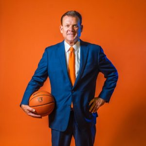 Illinois head coach Brad Underwood poses with a basketball. The team is currently struggling to create a non-conference schedule.