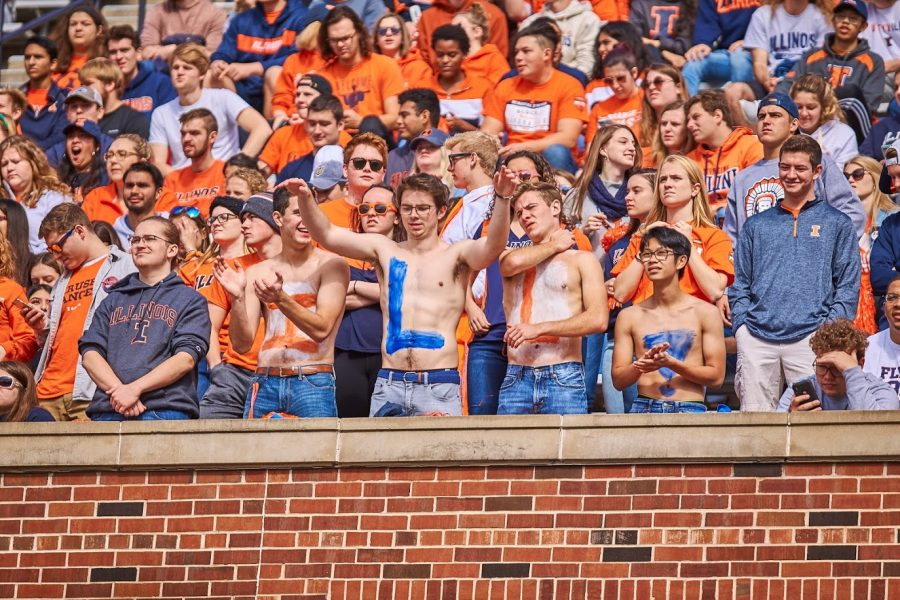 Students+in+the+Block+I+fan+section+cheer+during+the+game+against+Wisconsin+on+Oct.+19.+Block+I+is+a+student+organization+that+allows+students+to+show+their+support+for+Illini+sports+teams%3B+the+group+will+be+hosting+a+watch+party+for+the+return+of+the+football+season.