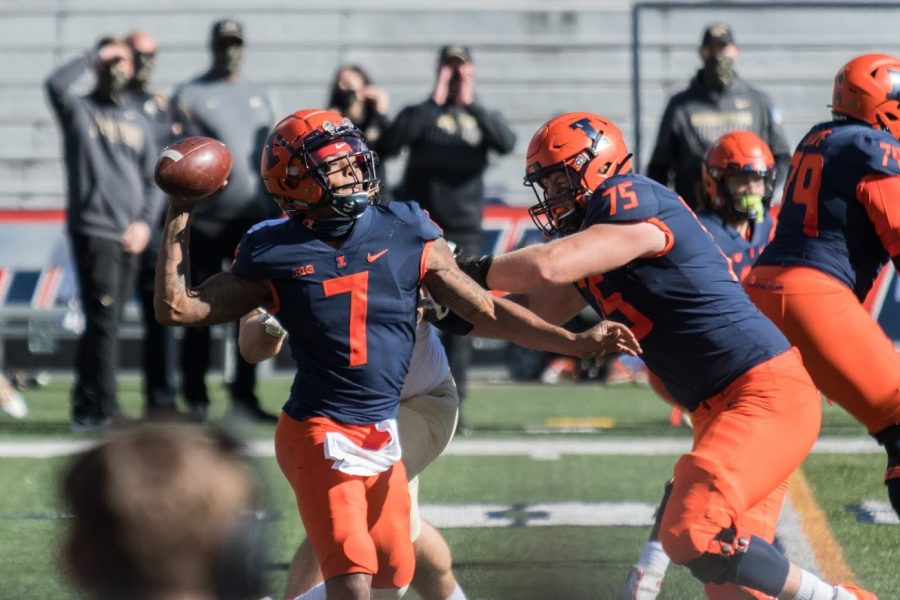 Sophomore quarterback Coran Taylor throws a pass under pressure during the game against Purdue on Oct. 31. The Illini fell to the Boilermakers 31-24.