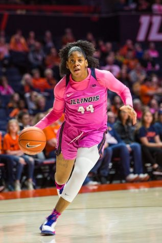 Sophomore forward Kennedi Myles advances the ball down the court during the game against Wisconsin on Sunday. The Illini lost the game 73-64.