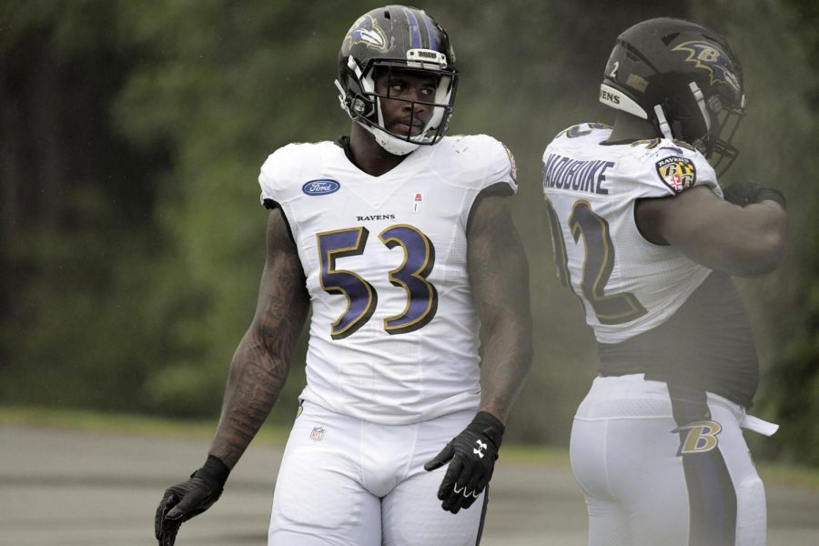 Baltimore+Ravens+defensive+end+Jihad+Ward+walks+behind+defensive+tackle+Justin+Madubuike+on+Aug.+19.+Ward+is+an+Illinois+alum+who+started+playing+for+the+Ravens+in+2019.