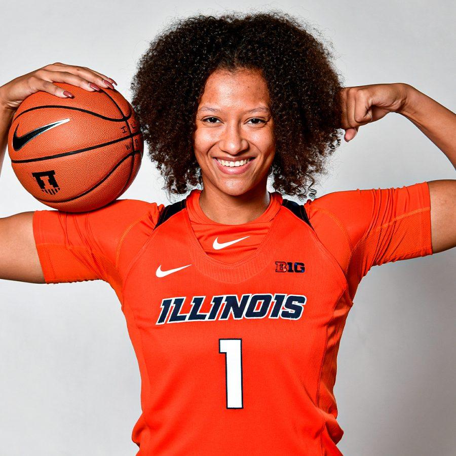 Redshirt junior Eva Rubin flexes with a basketball. Rubin transferred to Illinois from Arizona State in December 2019.